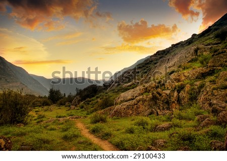 Colorful picture of sunset, mountain and path - stock photo