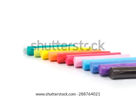 colorful piece set of modeling clay or plasticine with rainbow color for children play with they creativity, imagination and dream - stock photo