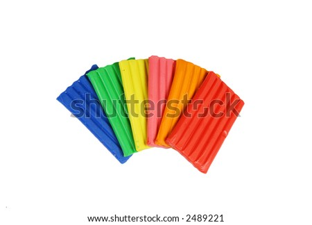 Colorful pieces of plasticine (isolated on white) - stock photo