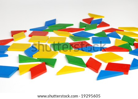 Colorful pieces of tangram - stock photo