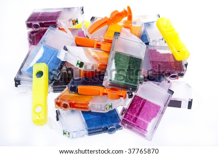 Colorful pile of inkjet printer ink cartridges empty and ready for recycling. - stock photo