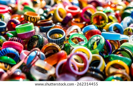 Colorful pile of rings texture.