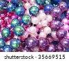Colorful pile of round Mardi Gras Beads - stock photo
