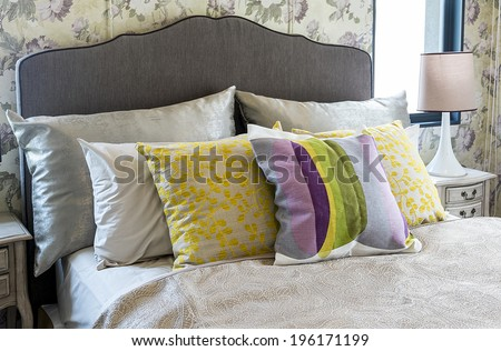 Colorful pillow on bed  - stock photo