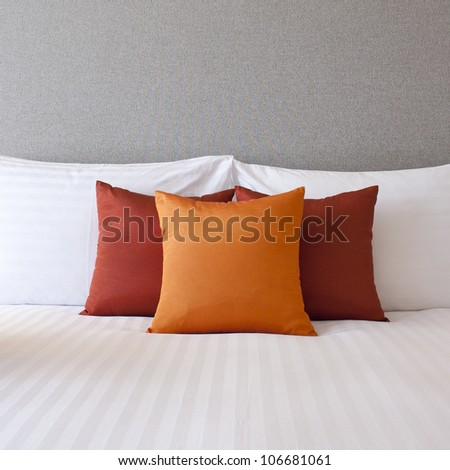 Colorful Pillow on hotel bed with space for text - stock photo
