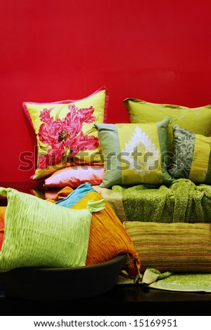 Colorful pillows and bedroom linen - home interiors. - stock photo