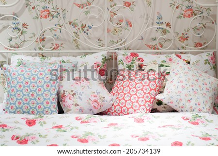 colorful pillows on a bed Comfortable soft pillows on the bed - stock photo