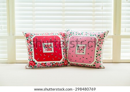 Colorful pillows on a sofa with white window background - stock photo
