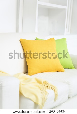 Colorful pillows on sofa - stock photo