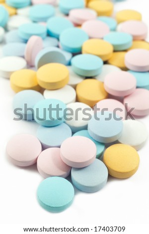 colorful pills and drugs isolated on white