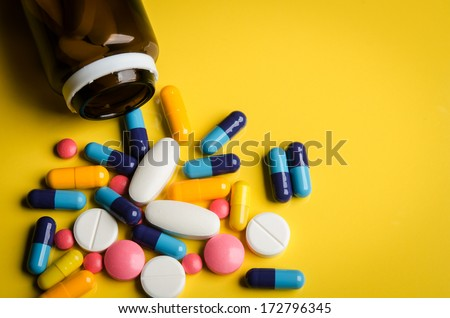 colorful pills and tablets on background - stock photo