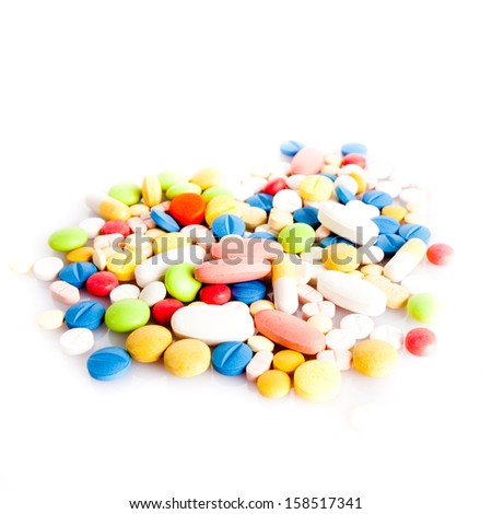 colorful pills isolated on white - stock photo