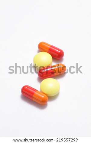 Colorful pills on white background  - stock photo