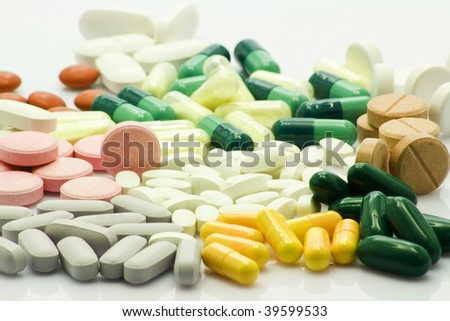 Colorful pills over wihte background