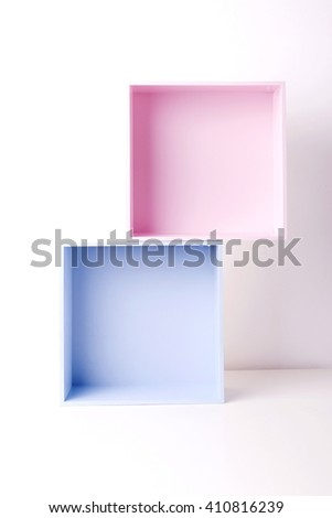 Colorful (pink and blue) wooden boxes, crates as shelves - stock photo