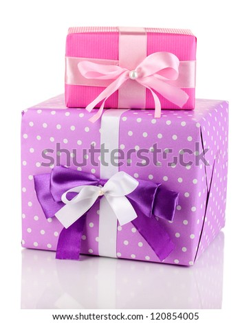 Colorful pink and purple gifts isolated on white - stock photo