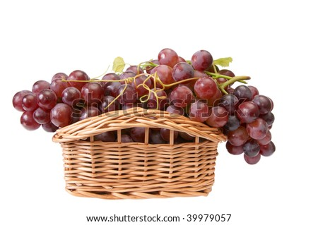 Colorful ,pink,tasty grapes in the basket isolated on a white background - stock photo