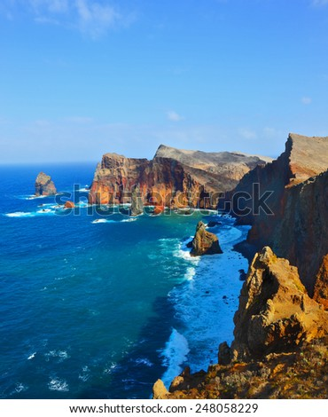 Colorful pinnacles lit sunset. Atlantic storms. Arid eastern tip of the island of Madeira - stock photo
