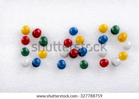 colorful pins/ Dad - stock photo