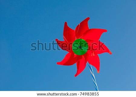 Colorful pinwheel against blue sky - stock photo
