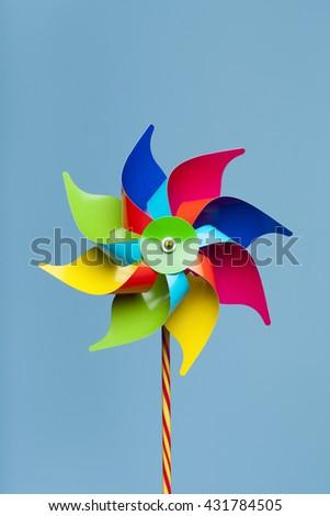 Colorful pinwheel isolated on blue background  - stock photo