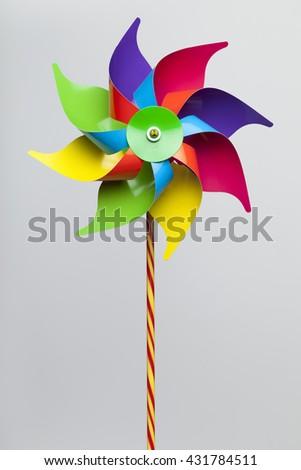 Colorful pinwheel isolated on grey background  - stock photo