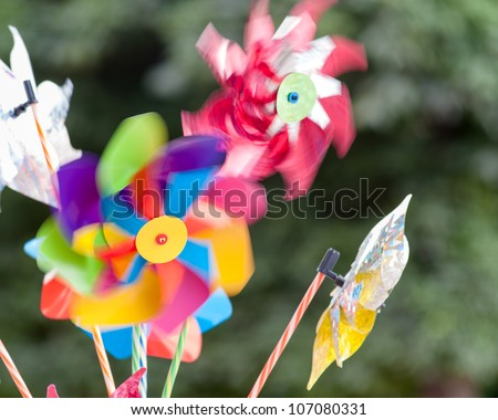 Colorful Pinwheels with motion blur - stock photo