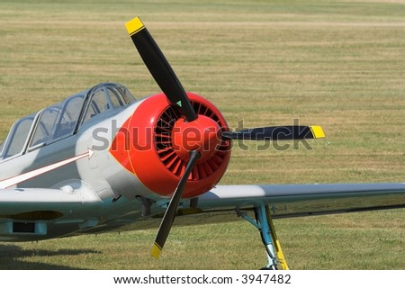 colorful plane on grass - stock photo