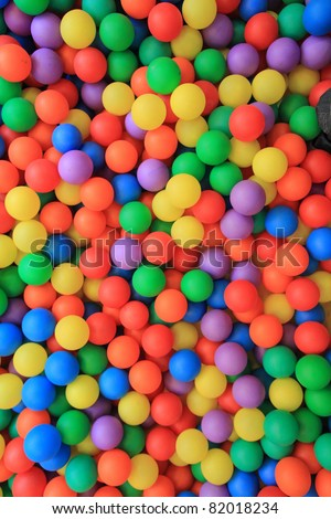 colorful plastic balls in children park background - stock photo