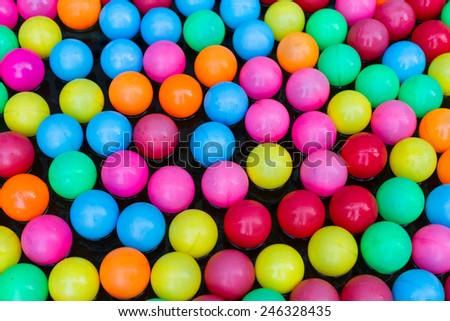 colorful plastic balls in water
