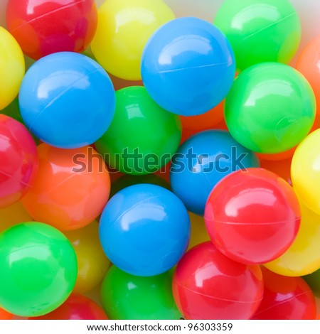colorful plastic balls on children's playground. - stock photo