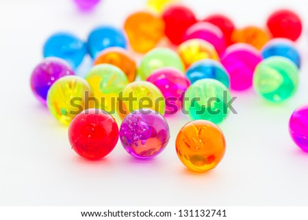 Colorful plastic balls on white background
