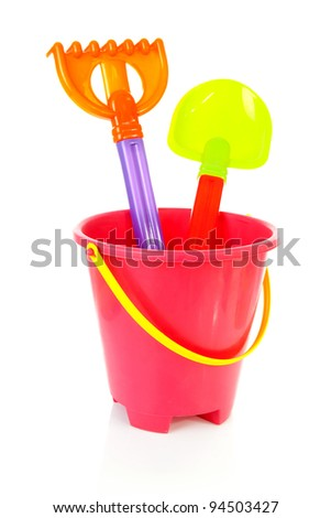 Colorful plastic beach toys over white background