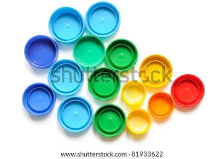 Colorful plastic bottle screw caps used to seal plastic bottles - stock photo