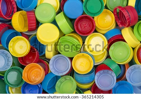 Colorful plastic caps ready for recycling - stock photo