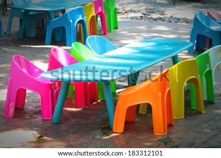 Colorful Plastic Chairs Are In The Garden