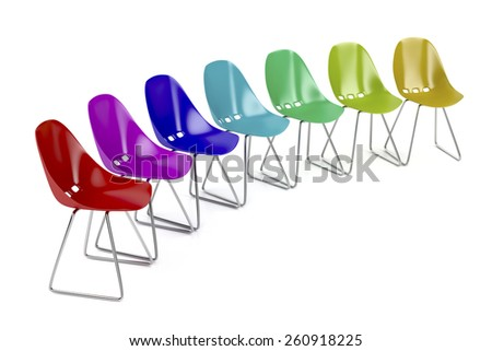 Colorful plastic chairs on white background  - stock photo