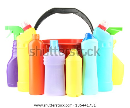 Colorful plastic detergent bottles with bucket, isolated on white