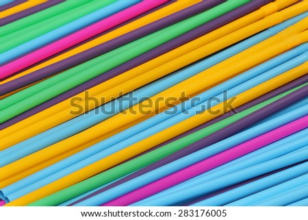 Colorful plastic drinking straws stripes abstract background