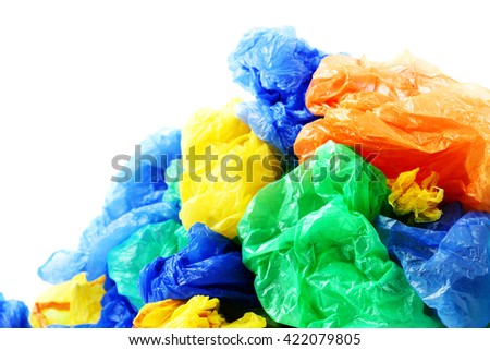 Colorful plastic garbage bags on a white background - stock photo