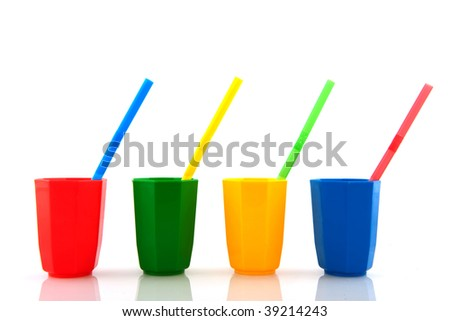 colorful  plastic glasses with drinking straws isolated over white