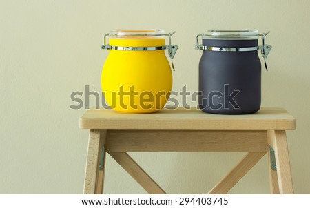 colorful plastic jar on table - stock photo