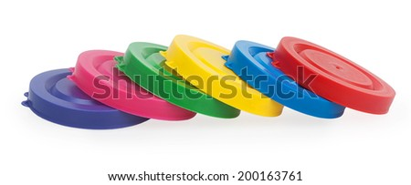 Colorful plastic lids for jars isolated on white background - stock photo