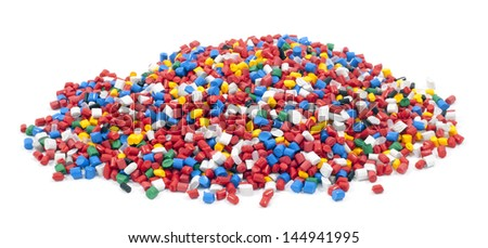 colorful plastic polymer granules on white background
