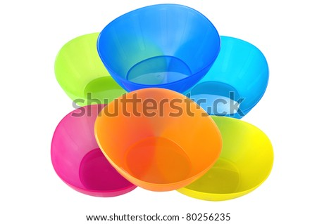 Colorful plastic snack bowls on white background. - stock photo