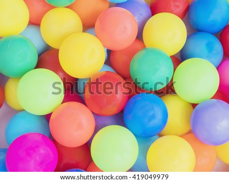 Colorful plastic toy balls background