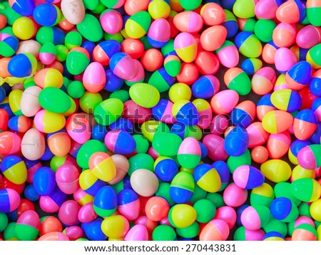 colorful plastic toy eggs in background and textures
