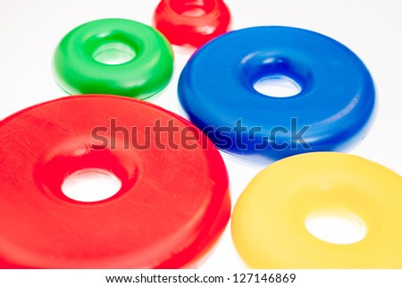 Colorful plastic toy rings on white background