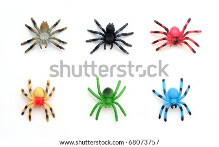Colorful Plastic Toy Spiders on White Background - stock photo