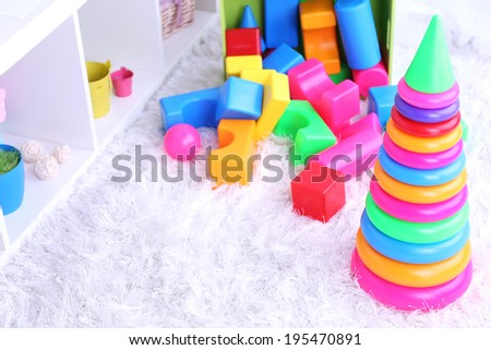 Colorful plastic toys in children room - stock photo
